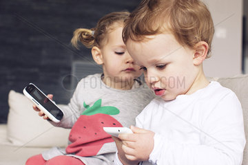 Children playing with smartphones