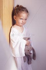 Little girl sulking in corner