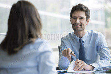 Insurance agent meeting with prospective customer