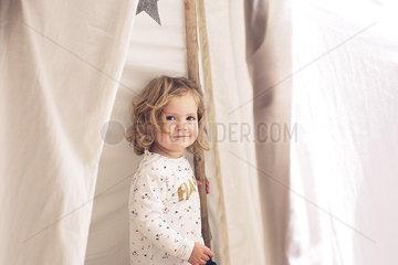 Little girl smiling in tent  portrait