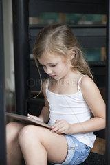 Little girl using digital tablet