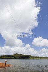 Man fishing on mountain lake