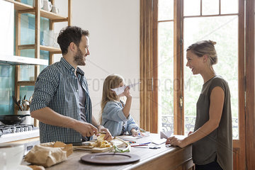 Family spending time together in kitchen