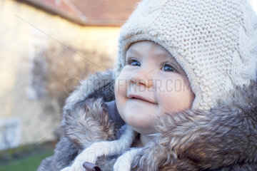 Baby wearing knit hat outdoors  portrait