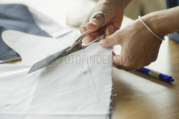 Woman cutting fabric  cropped