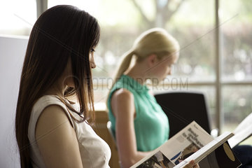 Woman reading magazine in waiting room