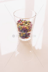 Colorful candies in glass