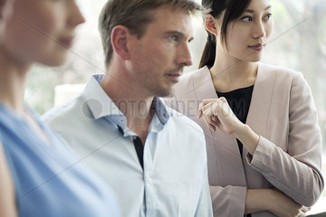 Businesswoman with colleagues at meeting