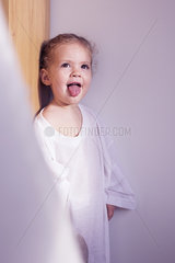 Little girl sticking out her tongue  portrait