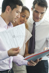 Businessman discussing documents with colleagues