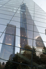 One World Trade Center reflected on building facade  Manhattan  New York City  New York  USA