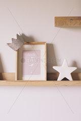 Knickknacks on shelf in little girl's room