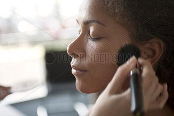 Applying foundation with make-up brush
