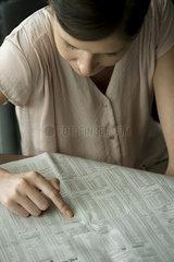 Woman searching job classified ads