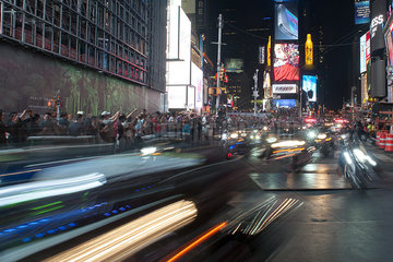 Tourists watching parade in Times Square at night  Manhattan  New York City  New York  USA