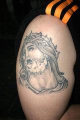 biceps and Jesus Tattoo