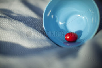 Single grape tomato in bowl