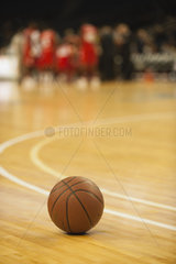Basketball resting on court