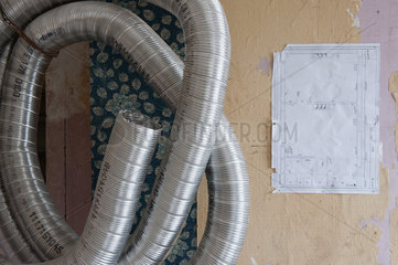Blueprint and metal pipe