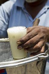 Vendor selling glass of lassi