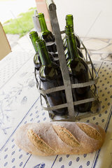 Bread and bottles of wine on table