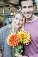 Couple with flower bouquet  portrait