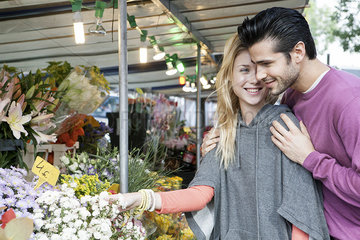 Young couple at flower market