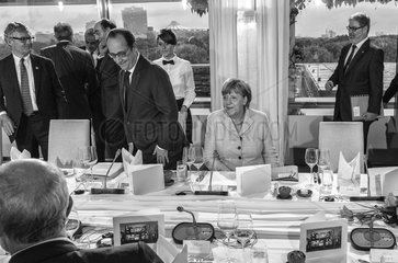 Hollande + Merkel + Roeller