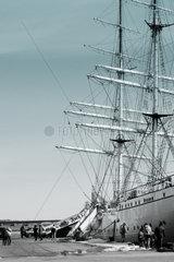 Angler und Segelschiff