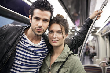 Couple on subway together  portrait