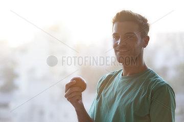 Man holding apple  portrait