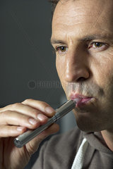 Man smoking electonic cigarette