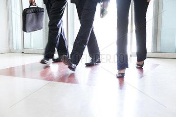 Business associates entering building together