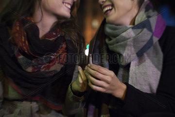 Friends bonding over cigarette