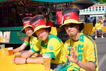 Germany. Berlin - brasilian and german football fan at a streetparty