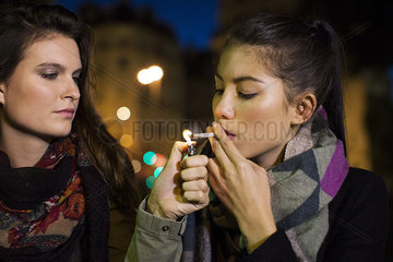 Young women smoking marijuana together