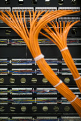 Network cables connected to computer mainframe