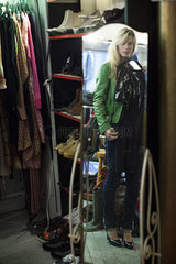 Woman in clothes shop trying on new dress
