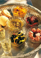 Italy  Apulia  mix of starters with local products as black olives  dried tomatoes  baby onions  green olive's pâte