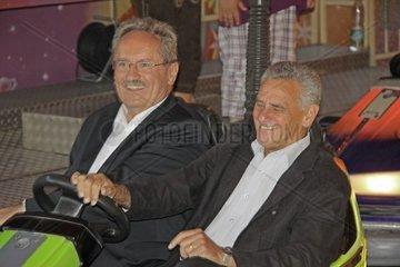 Christian Ude  SPD  in einem Autoscooter