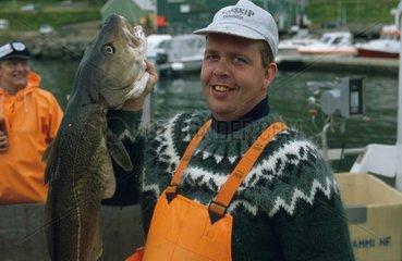 Fischer mit Fisch