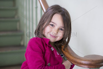 Little girl leaning against bannister  portrait