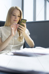 College student using smartphone during study break