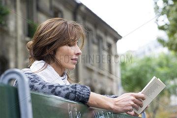 Tourist using guidebook