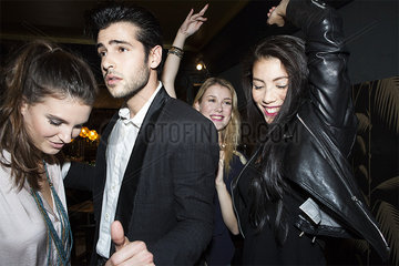 Young adults dancing at night club