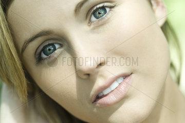 Teenage girl looking away dreamily  portrait