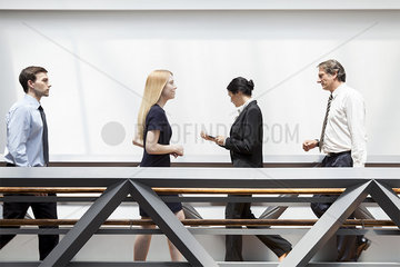Executives walking in corridor