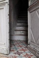 Half-open door leading to stairway