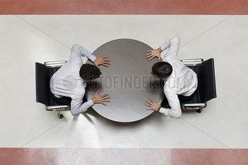 Businessmen face off in heat of negotiation