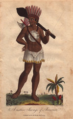 A Native Savage of America. Native American carrying a club  wearing a feathered headdress and short skirt  a large silver plate on his chest  armed with an axe.